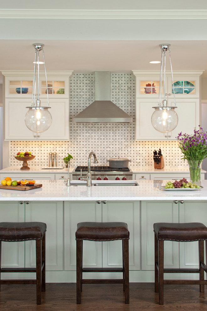 Inspiration for a large timeless u-shaped dark wood floor eat-in kitchen remodel in Minneapolis with an undermount sink, shaker cabinets, white cabinets, multicolored backsplash, stone slab backsplash, stainless steel appliances, an island and quartz countertops