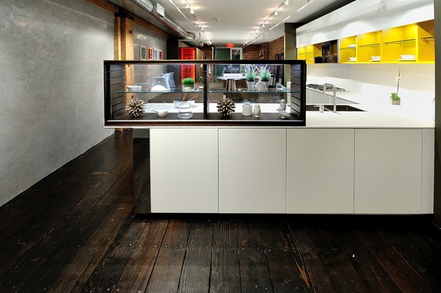 Modern, elephant gray kitchen cabinetry with stainless steel trim