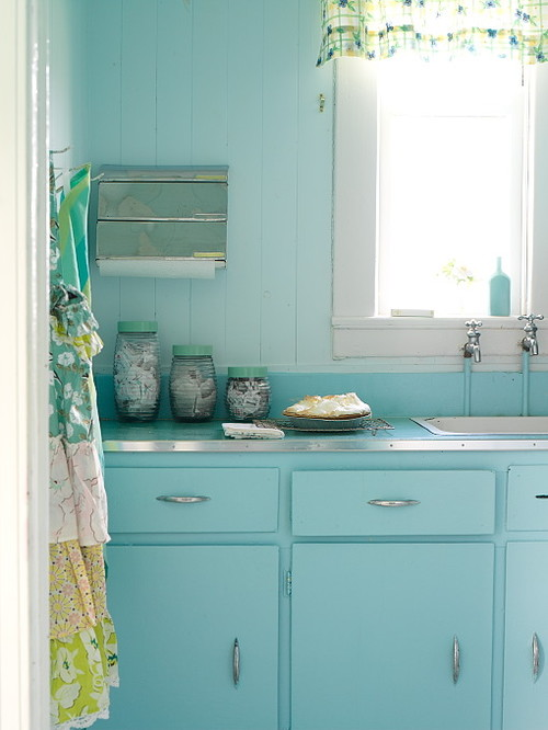 turquoise backdrop with cabinets