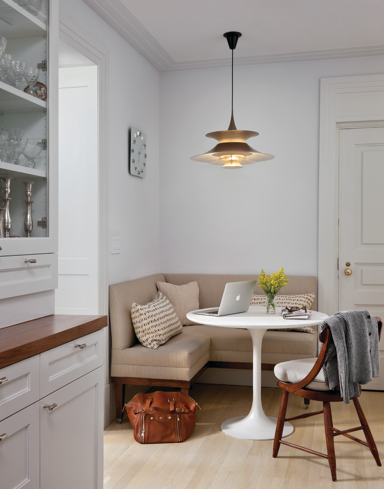 Example of a transitional dining room design in New York