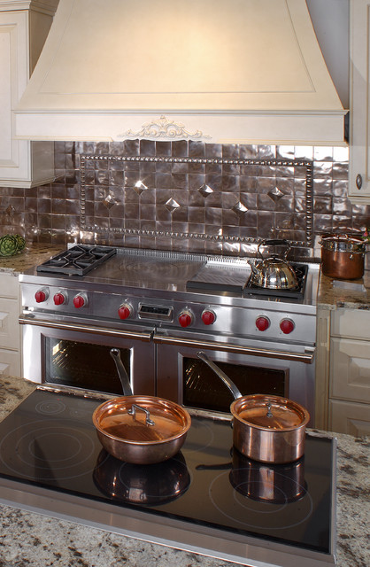 electric wolf cooktop with copper backsplash traditional