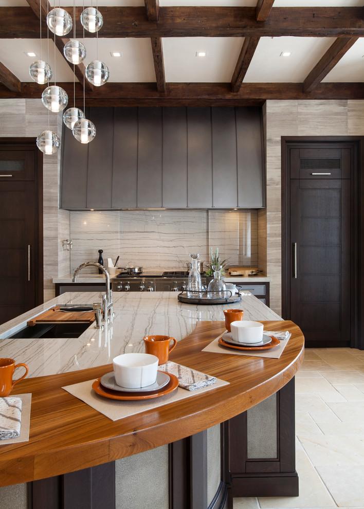Elegant kitchen photo in Denver with stone slab backsplash and wood countertops