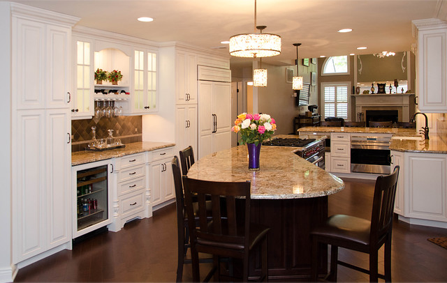 Elegant kitchen with large island traditional kitchen for Elegant kitchen island designs