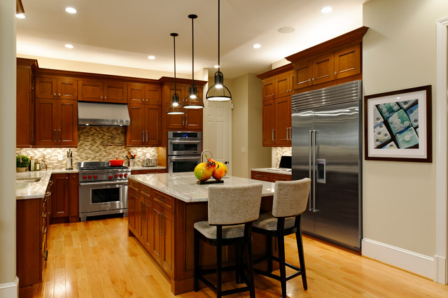 Elegant oakton kitchen dazzles traditional kitchen for Building traditional kitchen cabinets by jim tolpin