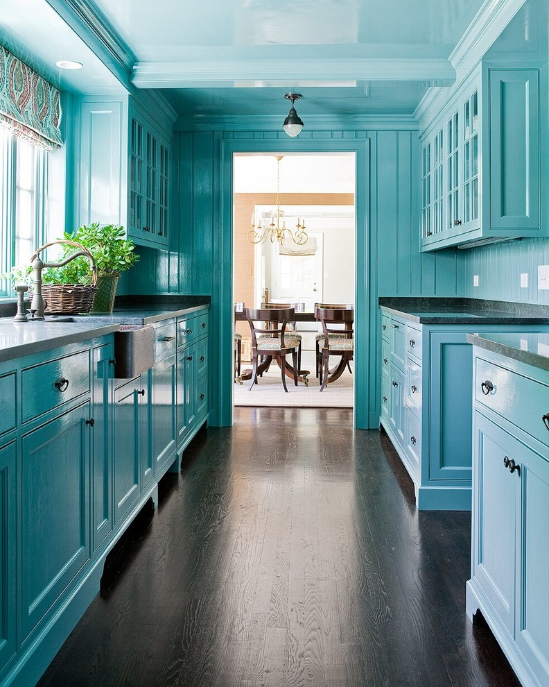 Inspiration for a timeless dark wood floor kitchen remodel in Boston with a farmhouse sink, recessed-panel cabinets, blue cabinets and blue backsplash