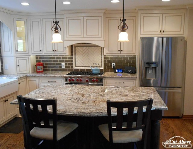 Elegant white kitchen dark mocha island traditional for Elegant kitchen island designs