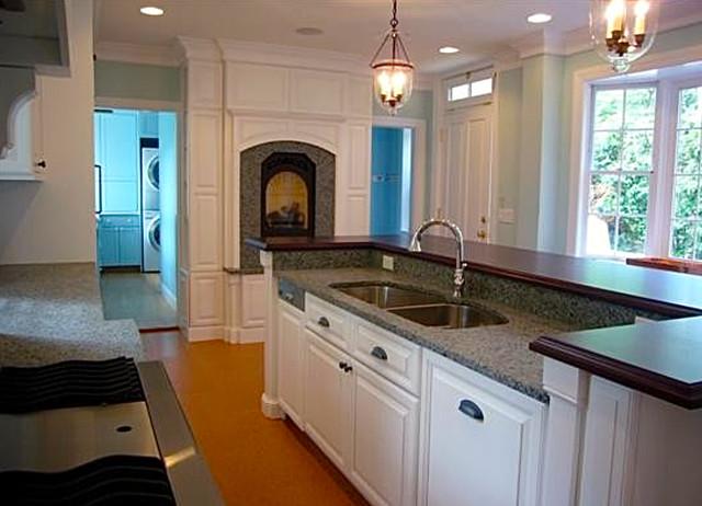 Elegant Granite Countertop Kitchens : Elegant white kitchen with fireplace and granite countertop