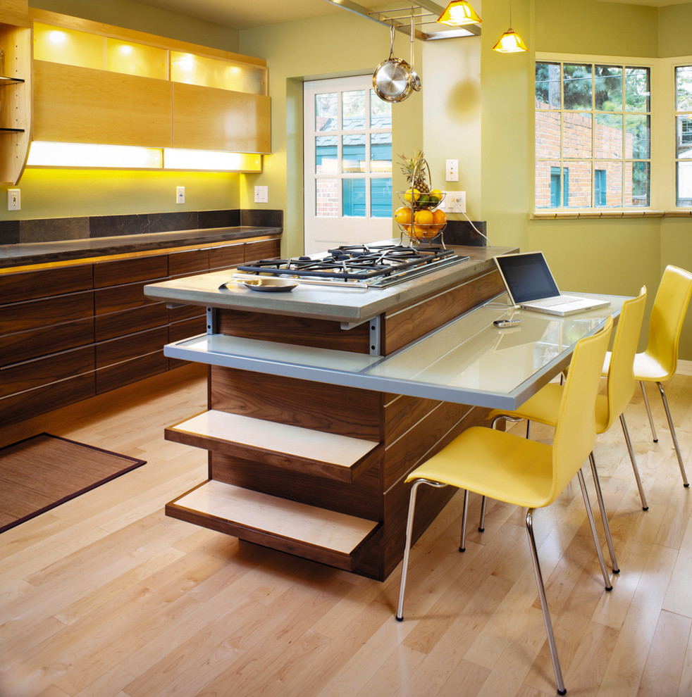 Enclosed kitchen - contemporary galley light wood floor enclosed kitchen idea in Denver with flat-panel cabinets, dark wood cabinets and an island