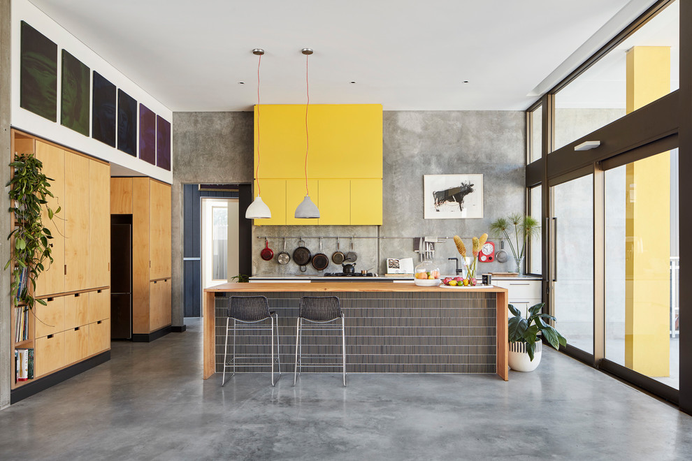 Mid-sized urban galley concrete floor kitchen photo in Perth with flat-panel cabinets and an island