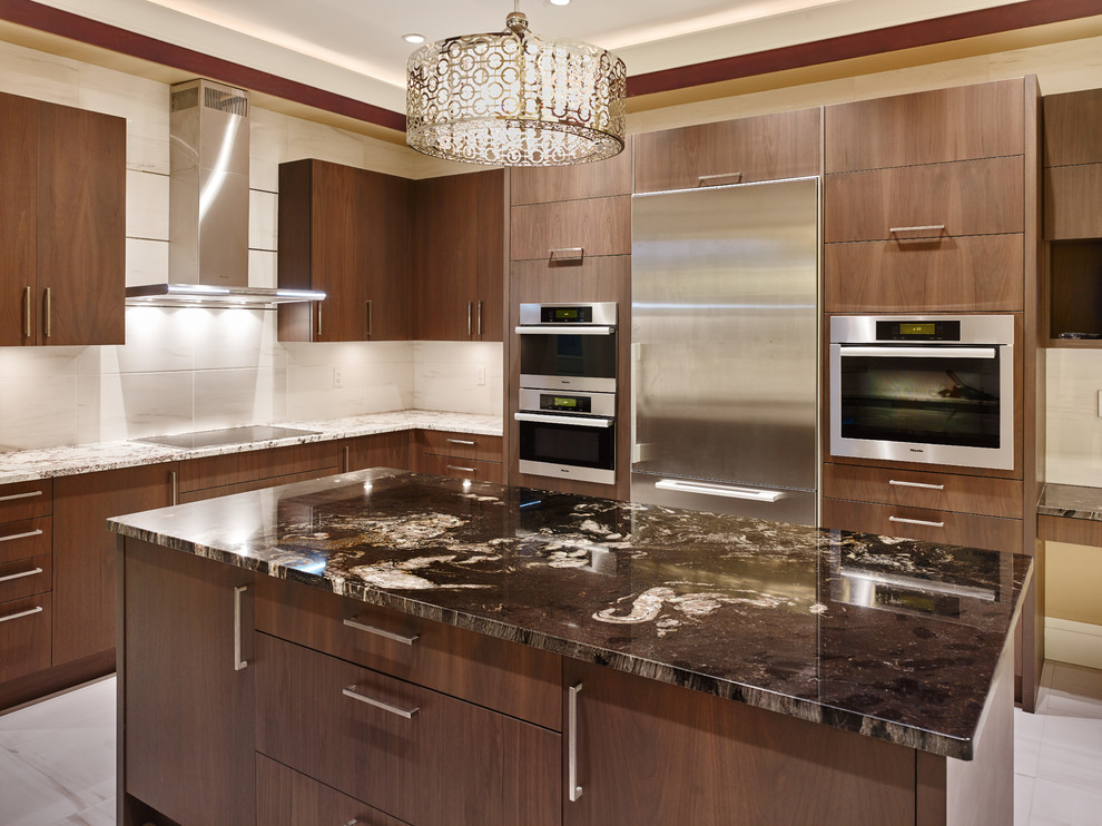 Example of a large transitional u-shaped ceramic tile eat-in kitchen design in Vancouver with an undermount sink, flat-panel cabinets, dark wood cabinets, granite countertops, ceramic backsplash, stainless steel appliances and an island