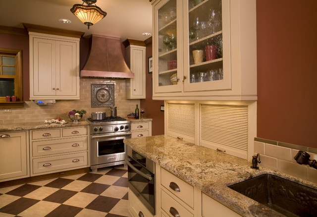 Example of a classic kitchen design in Portland with glass-front cabinets,  stainless steel