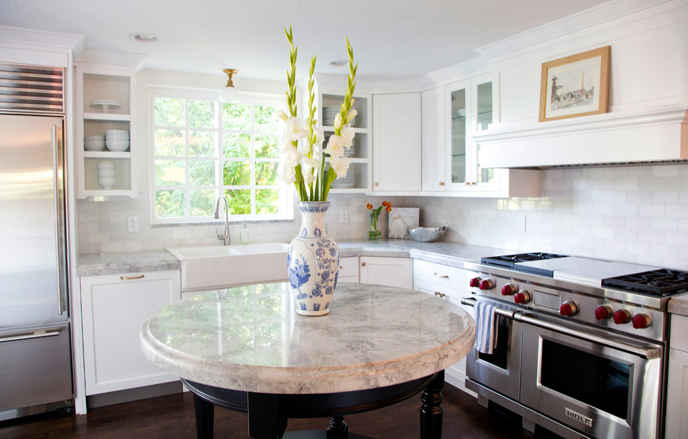 Example of a classic kitchen design in Salt Lake City with stainless steel appliances and a farmhouse sink