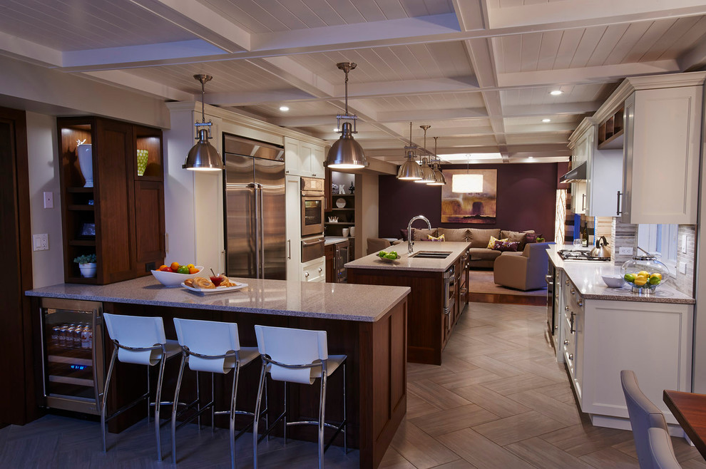 Elegant open concept kitchen photo in Toronto with white cabinets