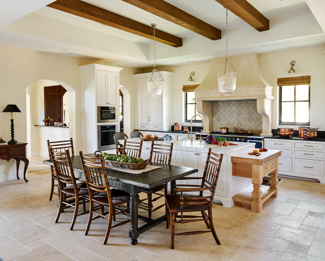 Example Of A Tuscan Beige Floor Eat In Kitchen Design In Other With White  Cabinets