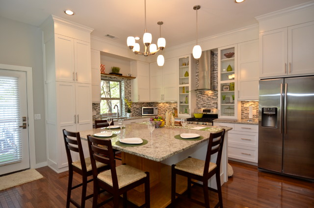 Kitchen - transitional kitchen idea in Austin with matchstick tile backsplash and stainless steel appliances