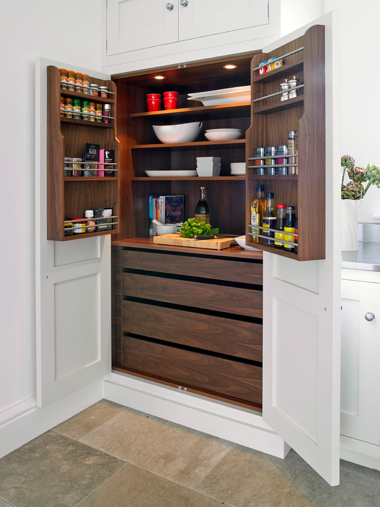 Example of a trendy kitchen pantry design in London with shaker cabinets and white cabinets