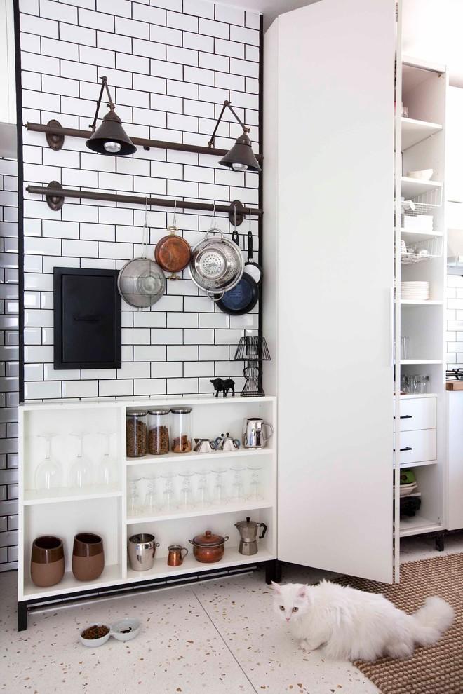 Kitchen - industrial kitchen idea in Other with flat-panel cabinets, white backsplash and subway tile backsplash