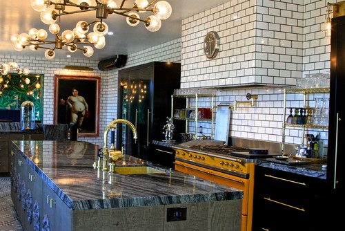 European Industrial kitchen with gold accents