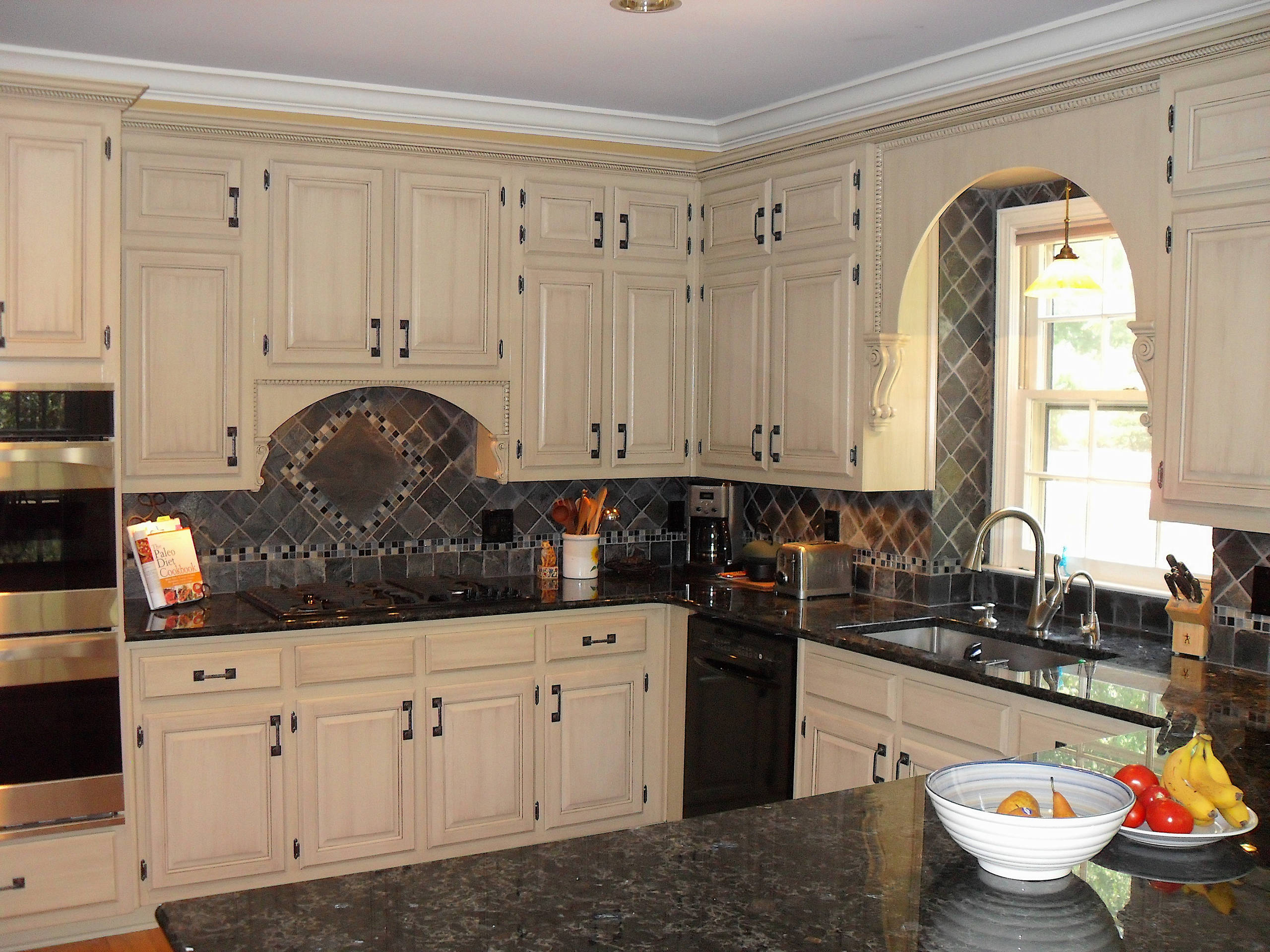 Exotic Finishes,Grained and antiqued oak kitchen cabinets.