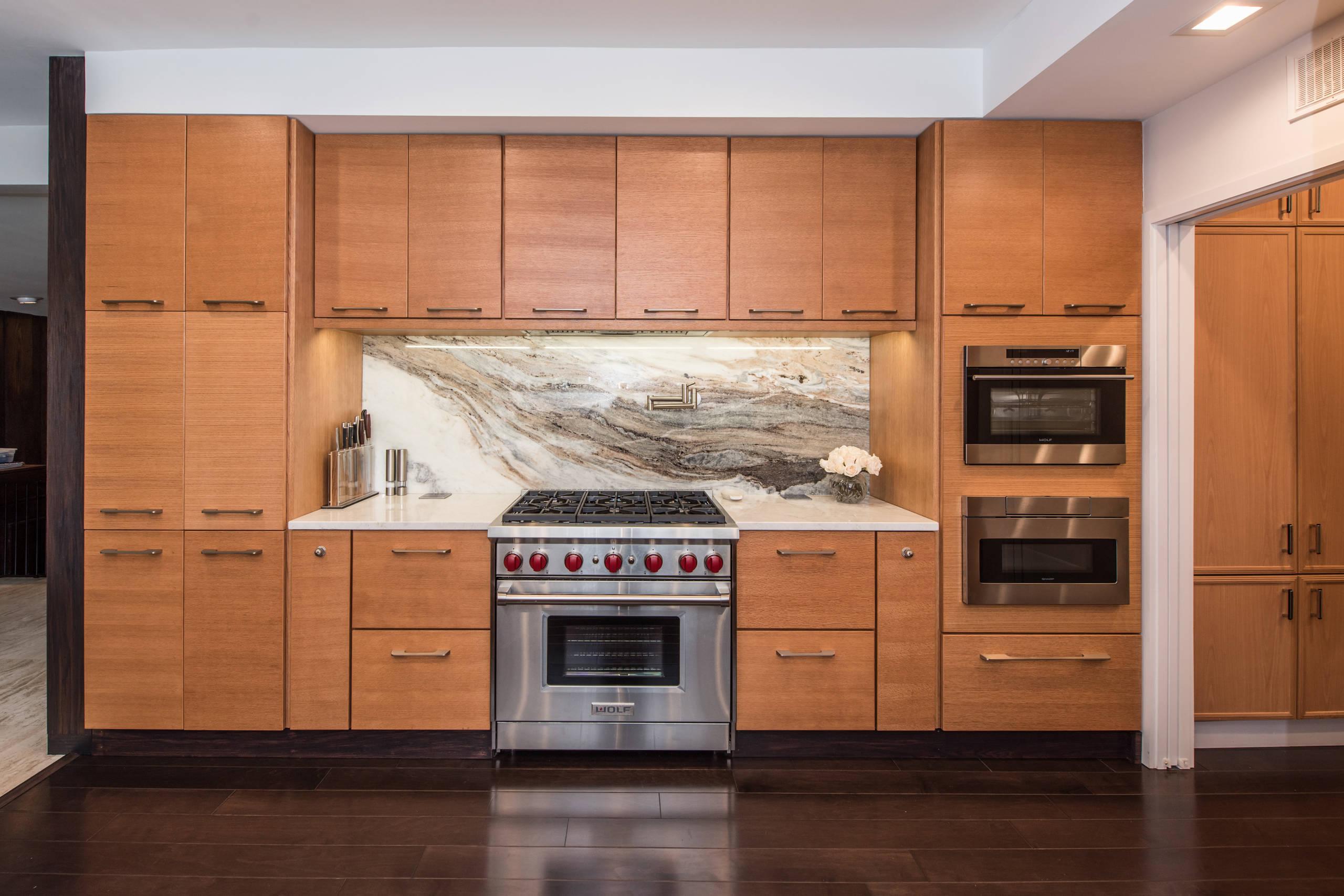 Expansive Wood Kitchen with Marble Back Splash