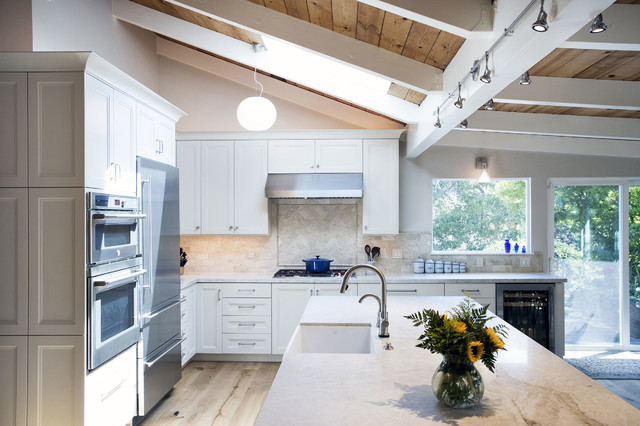 Exposed Beam Ceiling And White Cabinets