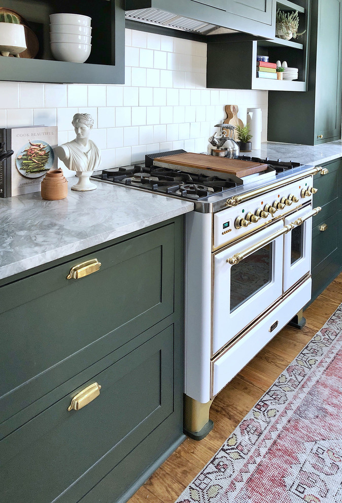 Small transitional l-shaped dark wood floor enclosed kitchen photo in Dallas with shaker cabinets, green cabinets and white backsplash