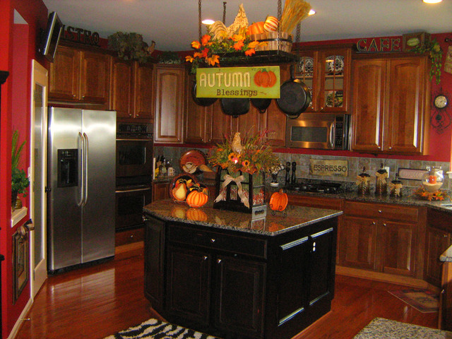 Decorating above kitchen cabinets ideas afreakatheart How to decorate top of cabinets