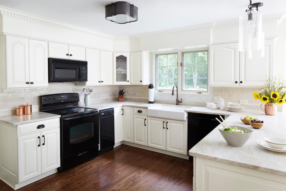 Kitchen - traditional u-shaped dark wood floor and brown floor kitchen idea in Chicago with a farmhouse sink, raised-panel cabinets, white cabinets, beige backsplash, subway tile backsplash and black appliances