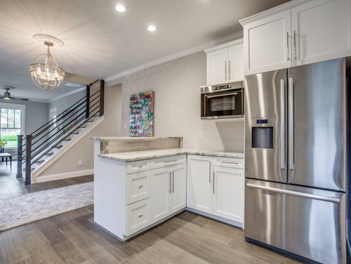 Transitional kitchen featuring Fantasy Brown countertops