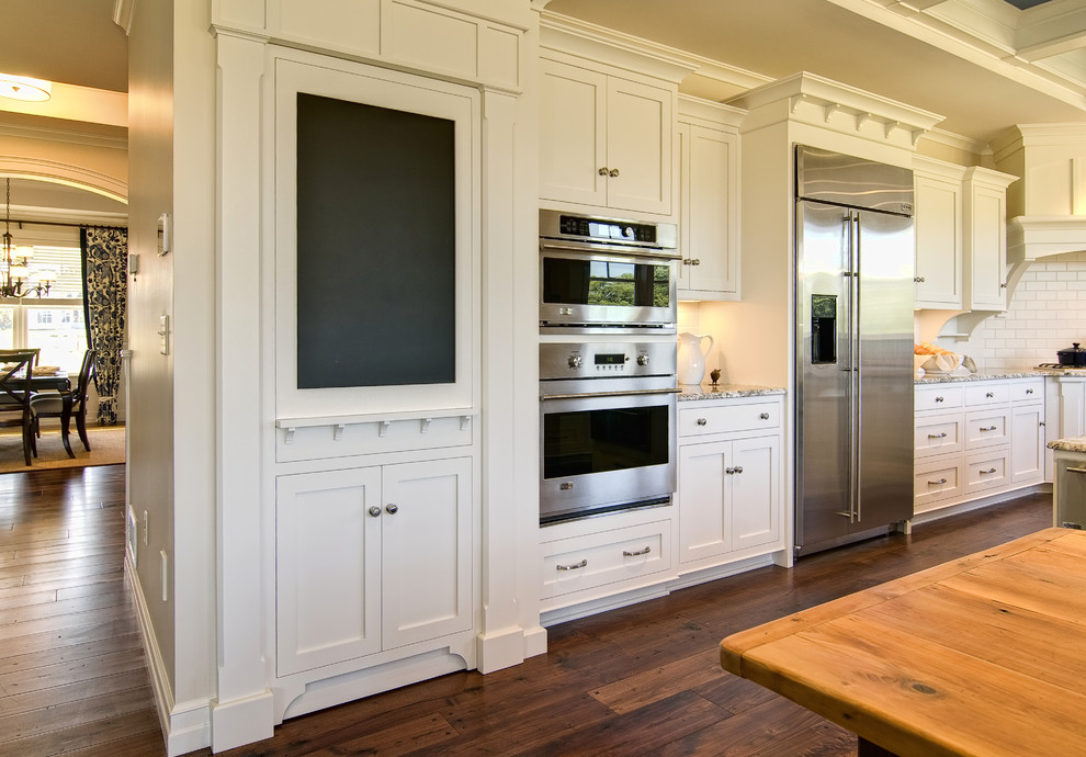 Kitchen - traditional kitchen idea in Other with stainless steel appliances and subway tile backsplash