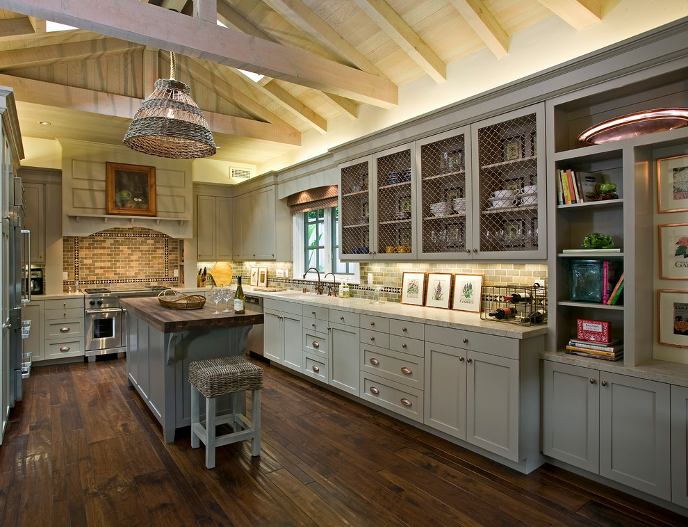 Kitchen - country u-shaped medium tone wood floor kitchen idea in Santa Barbara with marble countertops, gray cabinets, stainless steel appliances, recessed-panel cabinets, an undermount sink, gray backsplash, subway tile backsplash and an island