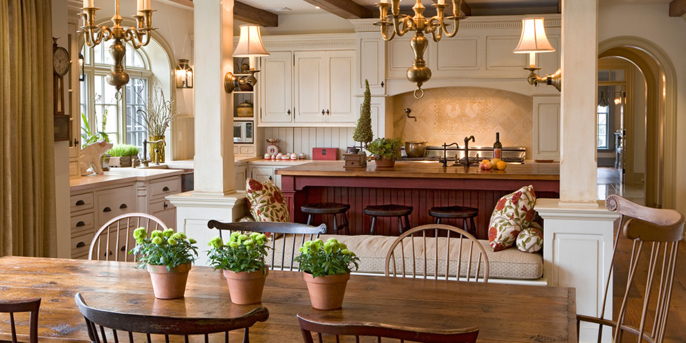 Eat-in kitchen - farmhouse eat-in kitchen idea in Philadelphia with raised-panel cabinets and white cabinets