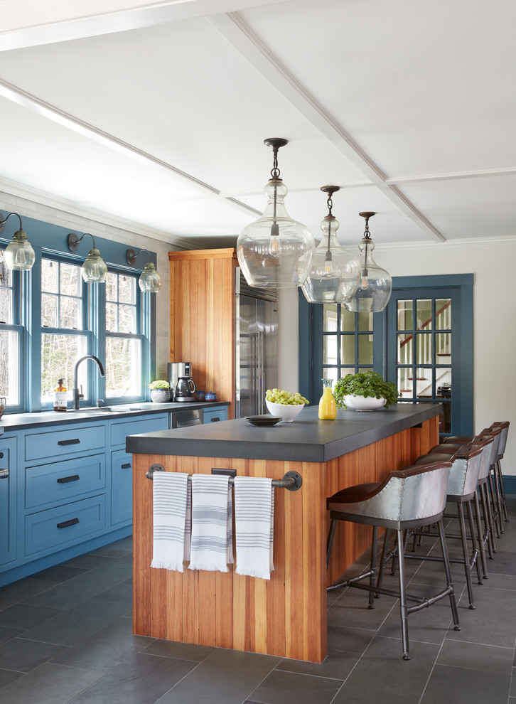 Eat-in kitchen - mid-sized farmhouse single-wall slate floor and gray floor eat-in kitchen idea in Boston with a single-bowl sink, recessed-panel cabinets, blue cabinets, limestone countertops, subway tile backsplash, stainless steel appliances, an island and white backsplash