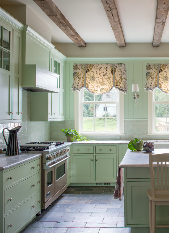 Eat-in kitchen - cottage u-shaped eat-in kitchen idea in DC Metro with shaker cabinets, green cabinets, marble countertops, beige backsplash, subway tile backsplash and stainless steel appliances