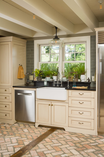 Kitchen - cottage brick floor kitchen idea in Other with a farmhouse sink, shaker cabinets, beige cabinets and stainless steel appliances
