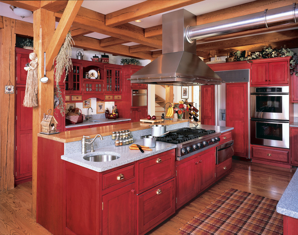 Country enclosed kitchen photo in Other with shaker cabinets, paneled appliances, an undermount sink and red cabinets