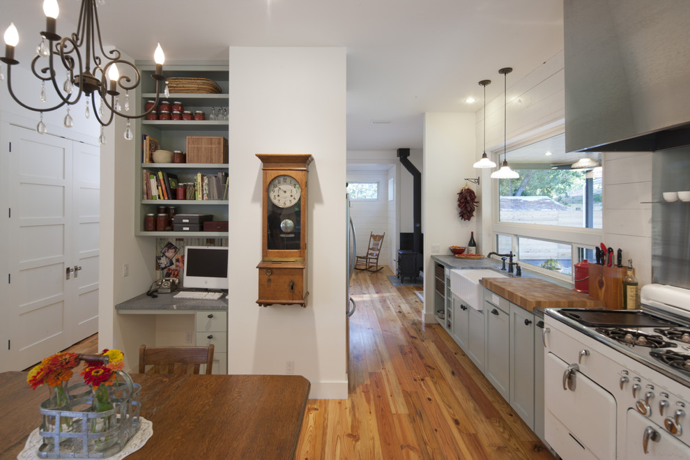 Inspiration for a farmhouse kitchen remodel in Austin with a farmhouse sink