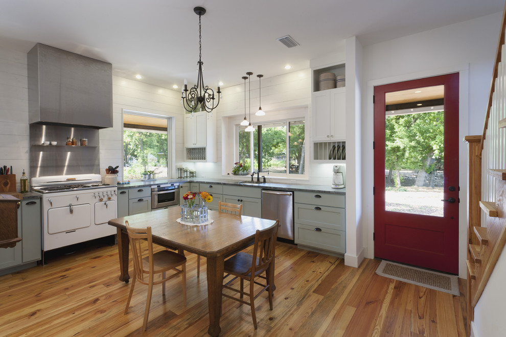 Country eat-in kitchen photo in Austin with white appliances, green cabinets and shaker cabinets