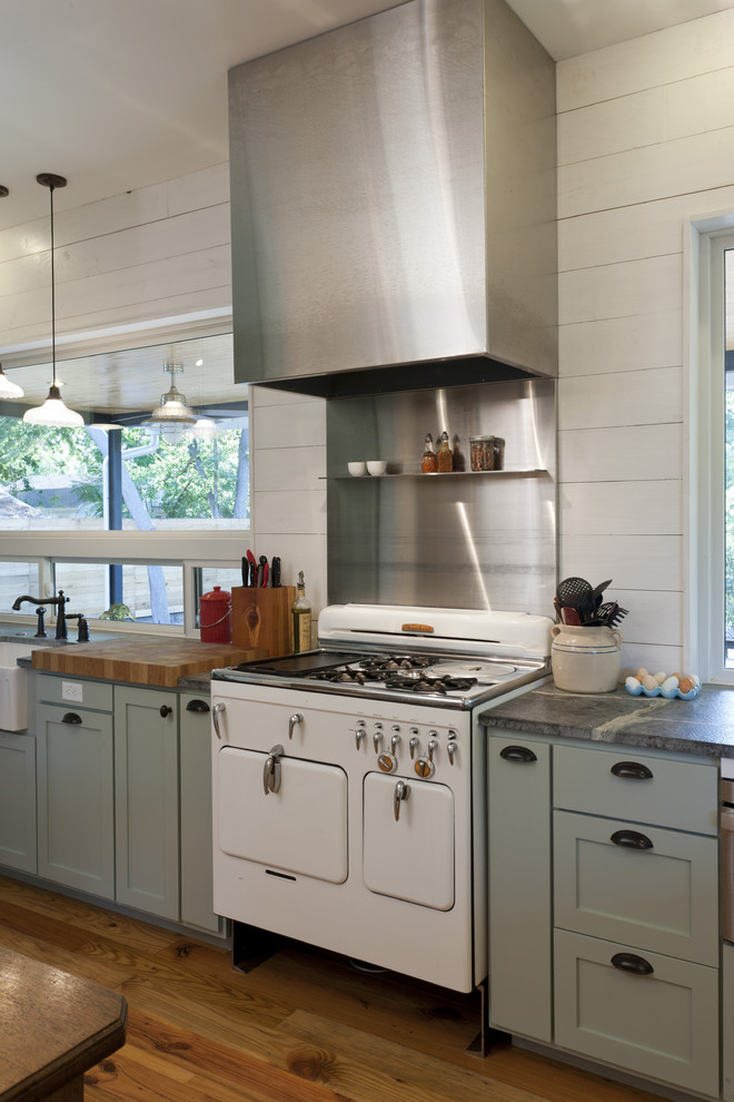 Example of a cottage kitchen design in Austin with white appliances, metal backsplash, metallic backsplash, gray cabinets, shaker cabinets and a farmhouse sink
