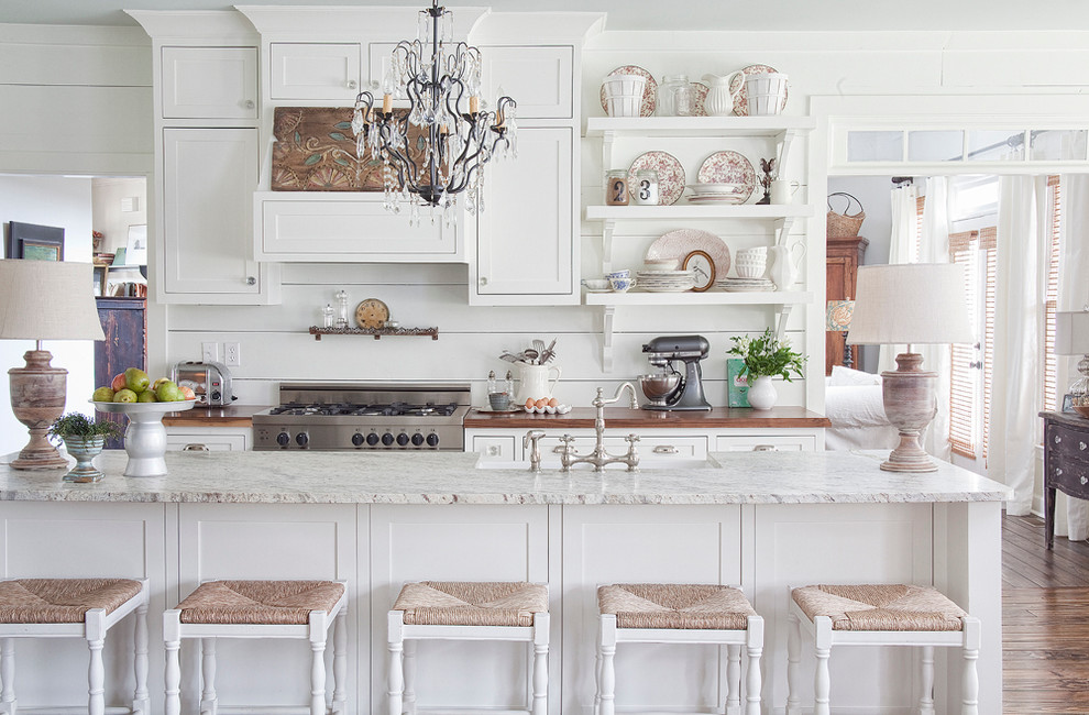 Inspiration for a cottage kitchen remodel in Atlanta with white cabinets and wood countertops
