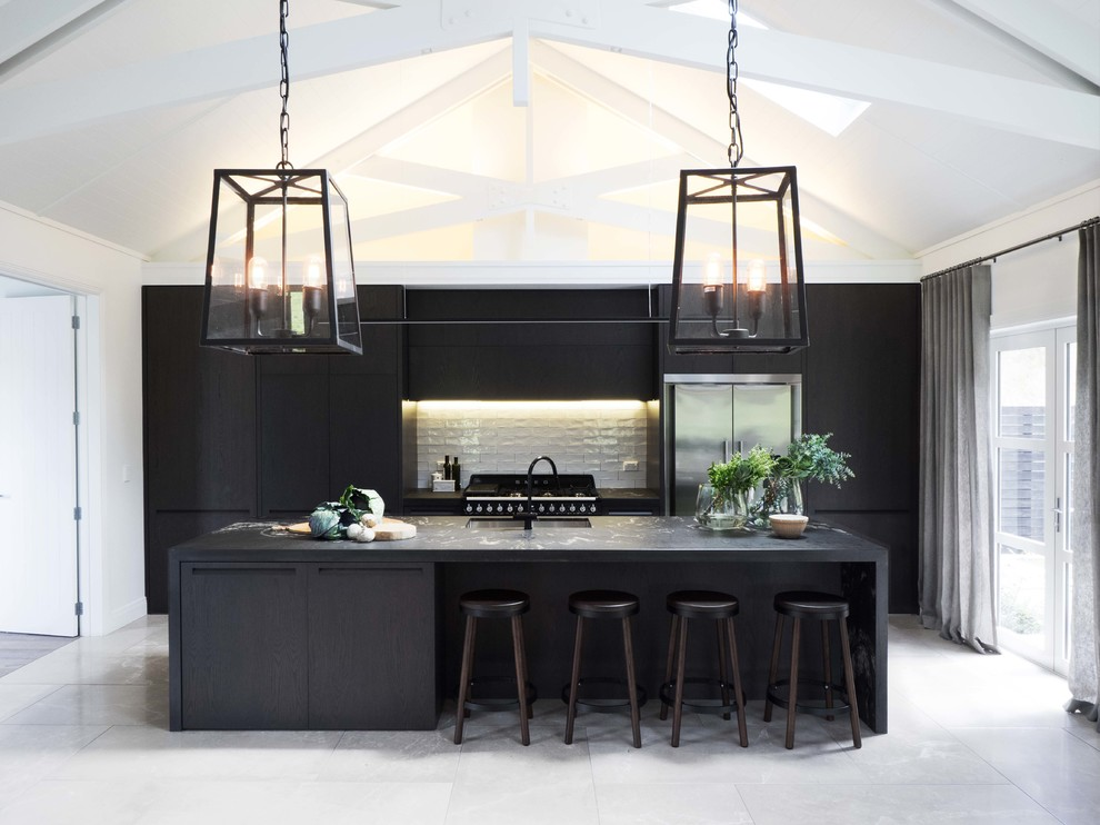 Inspiration for a mid-sized contemporary eat-in kitchen remodel in Auckland with flat-panel cabinets and black cabinets