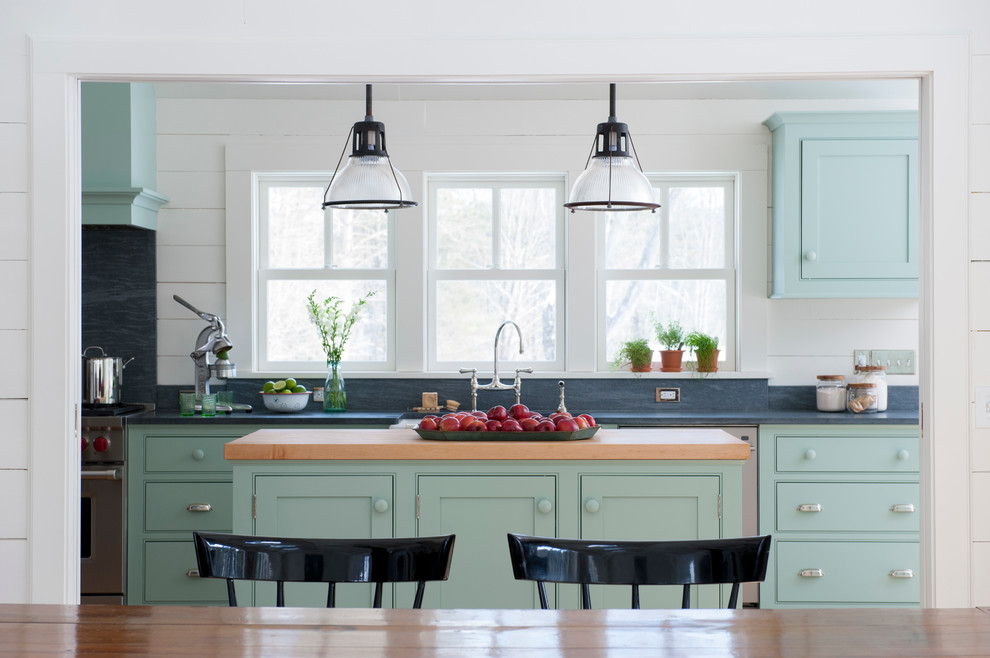 Example of a mid-sized cottage galley eat-in kitchen design in New York with beaded inset cabinets, blue cabinets, soapstone countertops, stainless steel appliances and an island