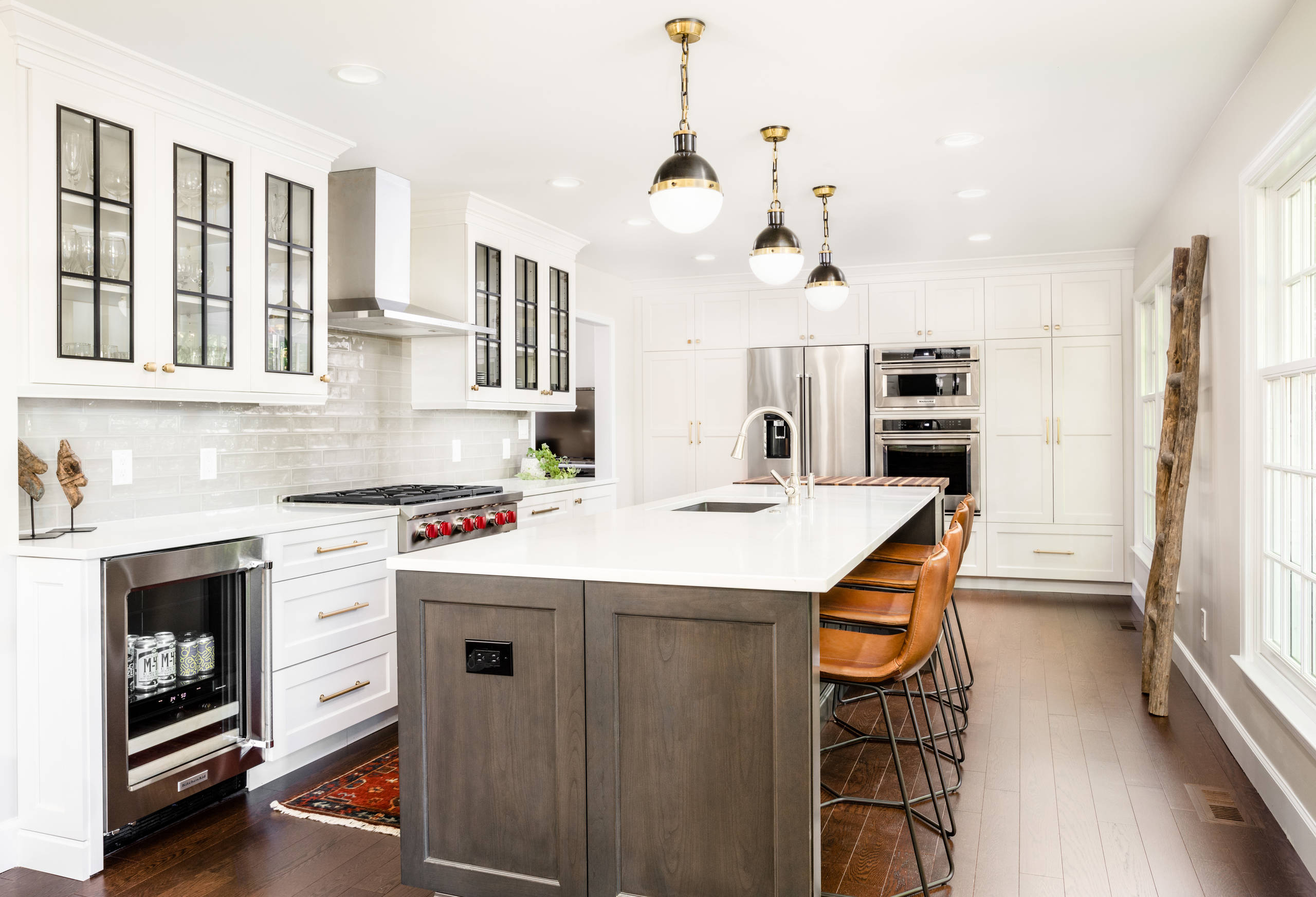 Eat-in kitchen - country l-shaped dark wood floor and brown floor eat-in kitchen idea in Detroit with an undermount sink, shaker cabinets, white cabinets, stainless steel appliances, an island, white