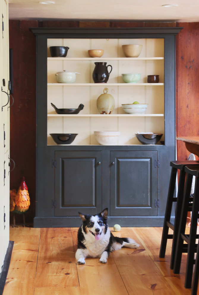Inspiration for a mid-sized cottage light wood floor kitchen pantry remodel in Boston with an undermount sink, beaded inset cabinets, black cabinets, wood countertops, white backsplash, an island, stone tile backsplash and paneled appliances