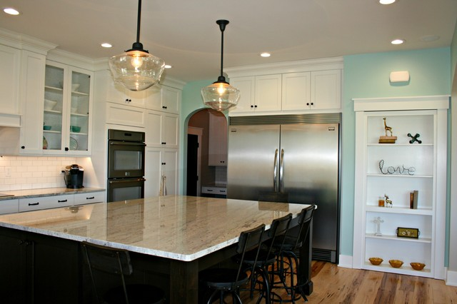 Farmstead road farmhouse kitchen omaha by oseka homes for Kitchen cabinets 60638