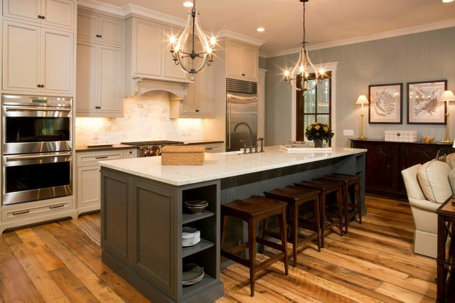 Huge elegant medium tone wood floor open concept kitchen photo in Charleston with recessed-panel cabinets, beige cabinets, granite countertops, stainless steel appliances and an island