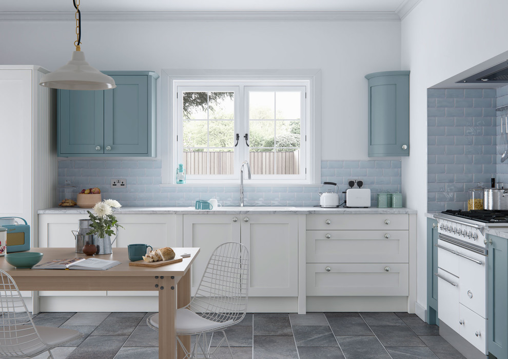 Inspiration for a mid-sized country l-shaped ceramic tile eat-in kitchen remodel in Manchester with shaker cabinets, white cabinets, blue backsplash, subway tile backsplash, no island, a drop-in sink, marble countertops and white appliances