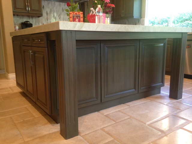 Mid-sized trendy eat-in kitchen photo in Orange County with recessed-panel cabinets, dark wood cabinets and an island