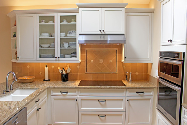 Inspiration for a mid-sized craftsman u-shaped medium tone wood floor open concept kitchen remodel in Seattle with a double-bowl sink, beaded inset cabinets, white cabinets, soapstone countertops, brown backsplash, stainless steel appliances and an island