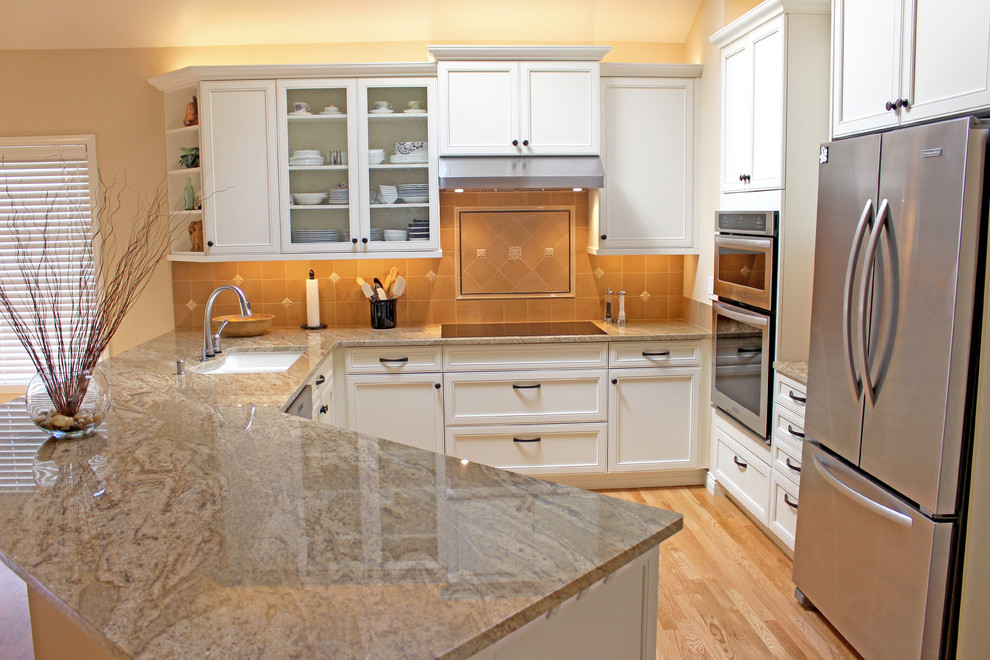 Eat-in kitchen - mid-sized traditional l-shaped light wood floor eat-in kitchen idea in Seattle with a double-bowl sink, recessed-panel cabinets, white cabinets, beige backsplash, stainless steel appliances, a peninsula and soapstone countertops